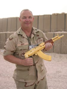 Holding a Gold plated AK-47 during Operation Iraqi Freedom