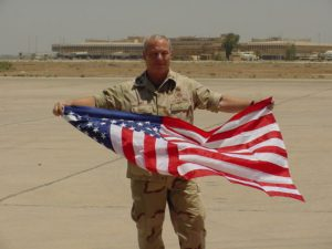 Hold the American Flag in Baghdad Iraq